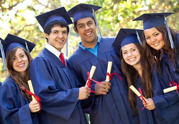 Graduating students smiling with diplomas, 8 Hidden College Expenses