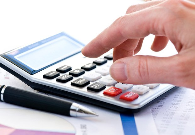 Tax calculator and pen, Bad Money Moves
