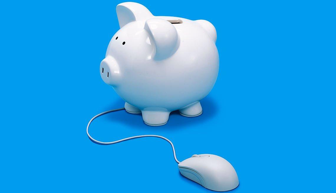 Una marranito de alcancía color blanco con un ratón de computador conectado a él -  Uso de bancos en línea