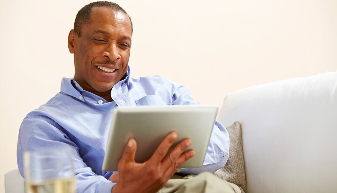 Man with a tablet, What's Your Financial IQ: Quiz