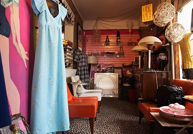 Clothing and Furniture in Crowded Second Hand Store. (Moodboard/Alamy)