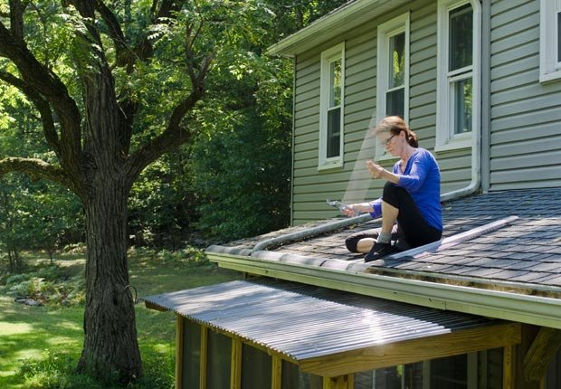 Install gutter leaf guards.  $100 or less DIY home fixes. (Kakimage/Alamy)