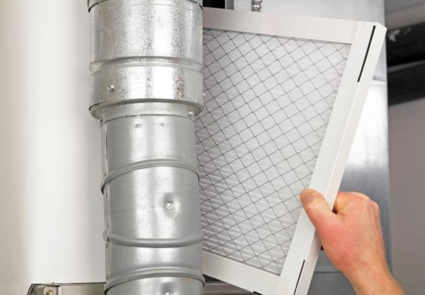 Change the filter in your home furnace. (Serenethos/Alamy)