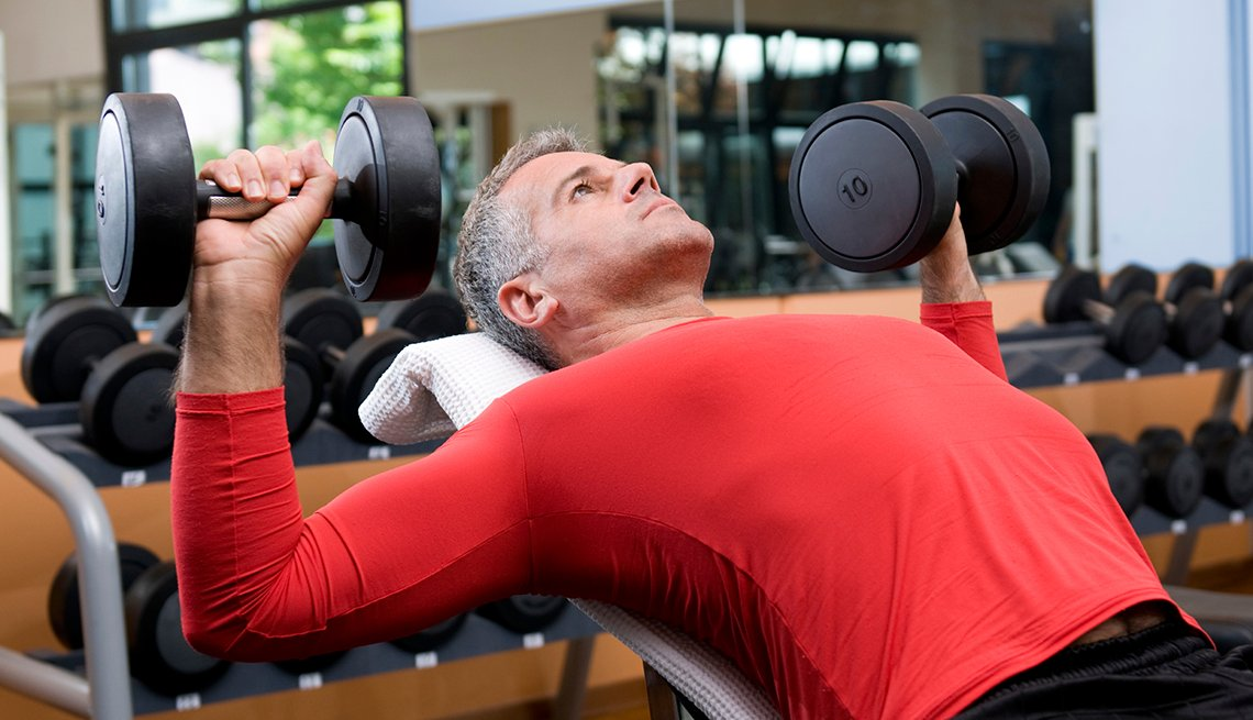Man Lifting Weights, Common Spending Regrets