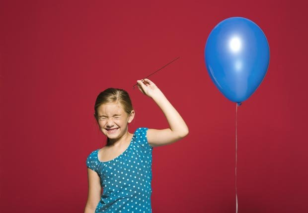 A girl ready to burst a balloon, Balloon loans are bad to co-sign