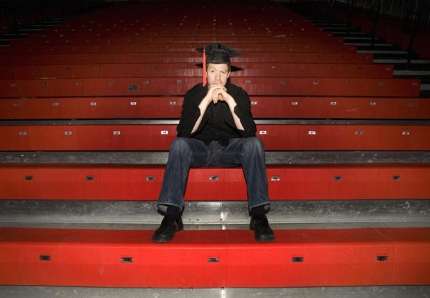 Student sits in bleachers, Private student loans are bad to co-sign
