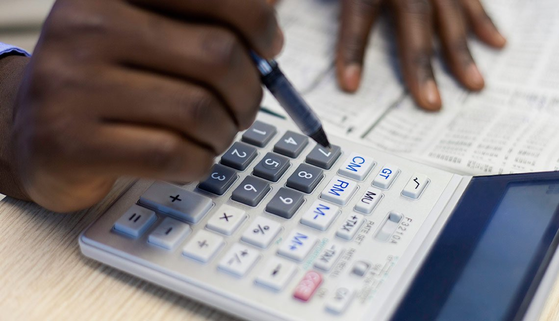 hands using calculator, retirement planning