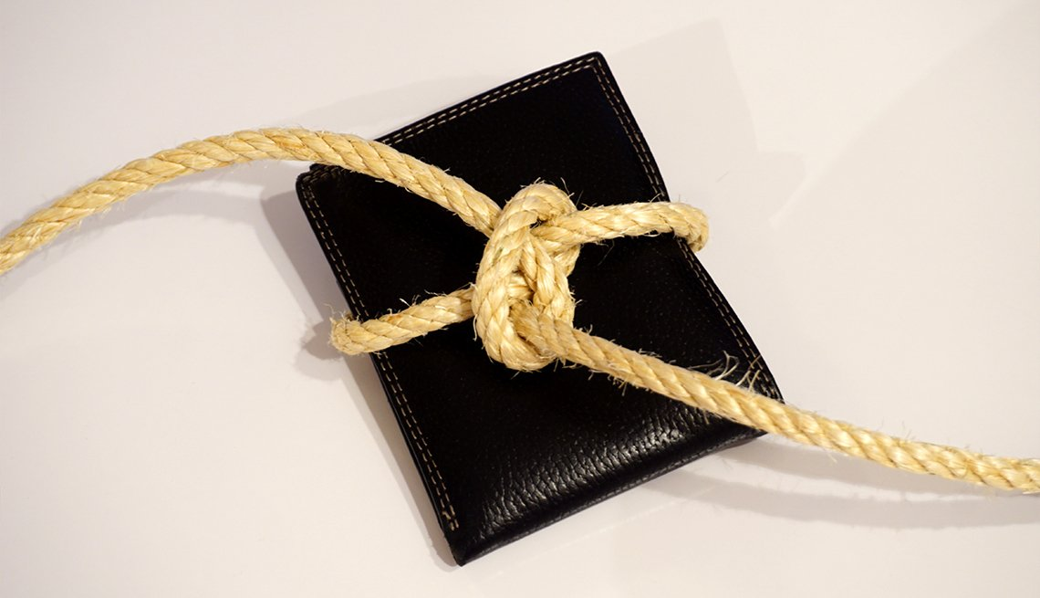 Black wallet tied with a rope, on the white background