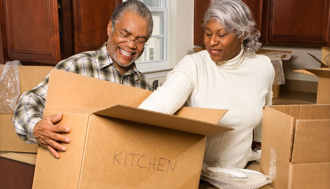 Middle-aged couple unpacking boxes, Writing off job hunt expenses