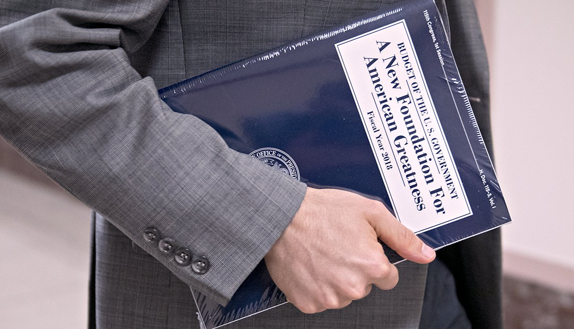 TRUMP BUDGET Response, person carries copy of new budget book