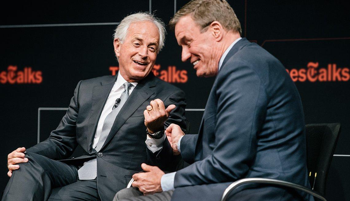 Sen. Mark Warner (D-VA) and Sen. Bob Corker (R-TN), talk politics during a conference
