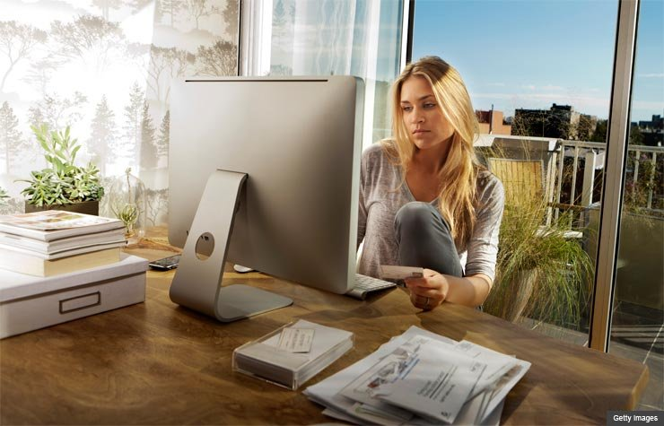 Woman purchasing items online (Getty Images)