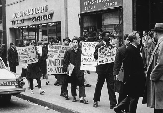 People marching with placards during an anti-segregation demonstration on a sidewalk in front of Horn and Hardart Automat Cafeteria, New York City., Golden Jubilee of the 1964 Civil Rights Act