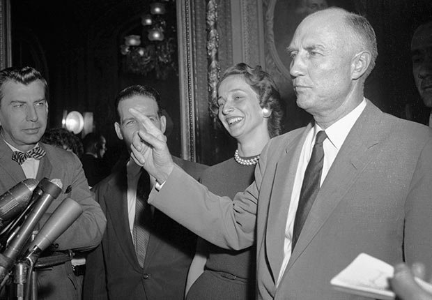 Senator Strom Thurmond is mobbed by reporters as he steps from the Senate Chamber after ending his 24-hour, 18-minutes talkathon against the Civil Rights Bill, Golden Jubilee of the 1964 Civil Rights Act