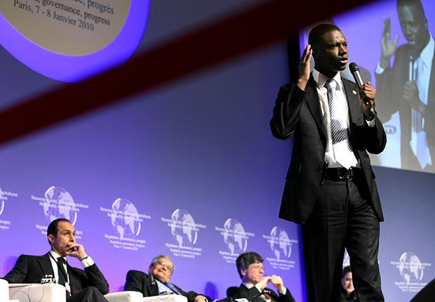 Chairman of the Young Democrats of America, Thione Niang speaks during the symposium 'New World New Capitalism' in Paris, France.