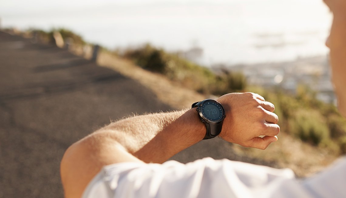 Fitness, man looking at watch, outdoors, Trends in 2015