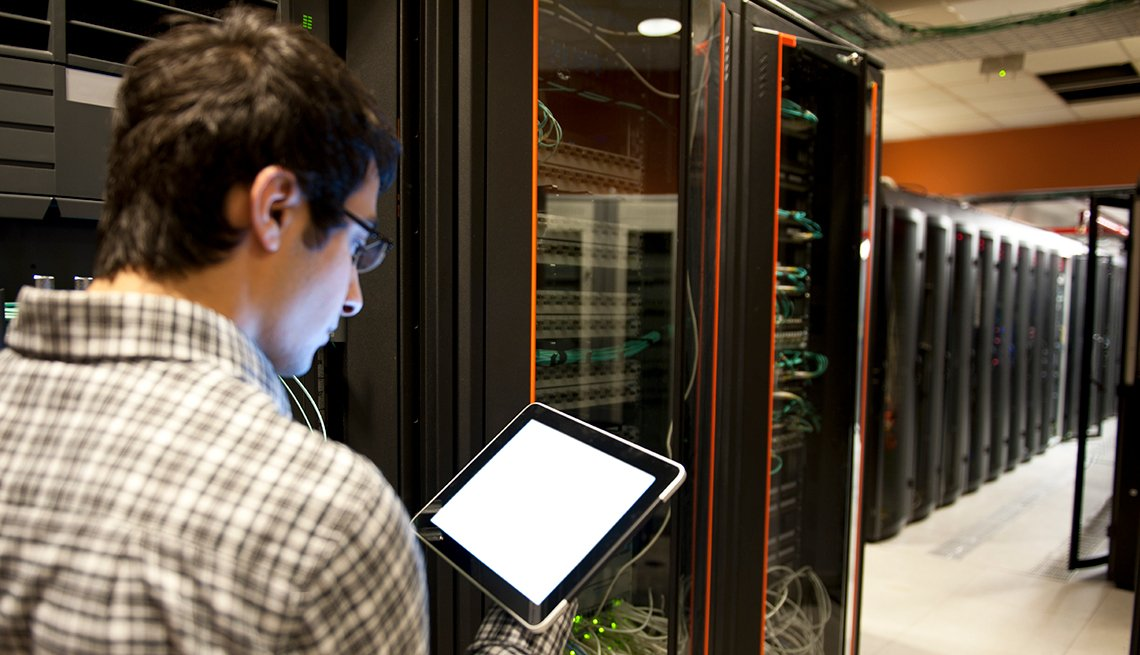 Man with tablet, computer server room, information technology, Technology job, Trends in 2015