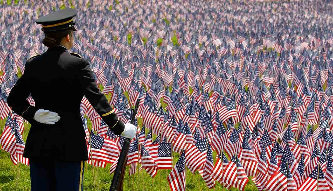 Service member facing field of American flags, Memorial Day, AARP Quiz