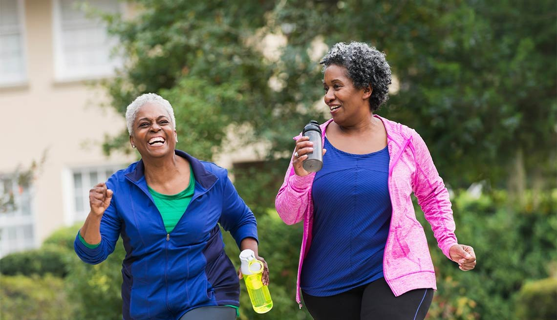 Two senior african american women exercising together, Exercise effects the brain