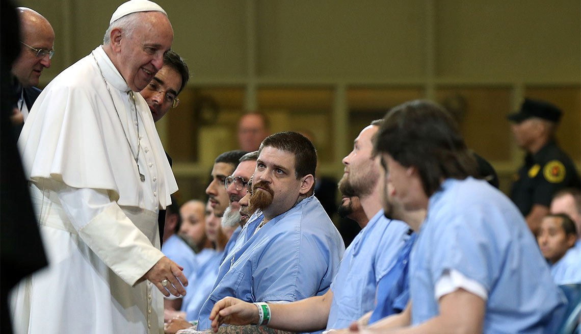 Pope Francis greets inmates during his visit to Curran Fromhold Correctional Facility in Philadelphia, Sunday, Sept. 27, 2015.