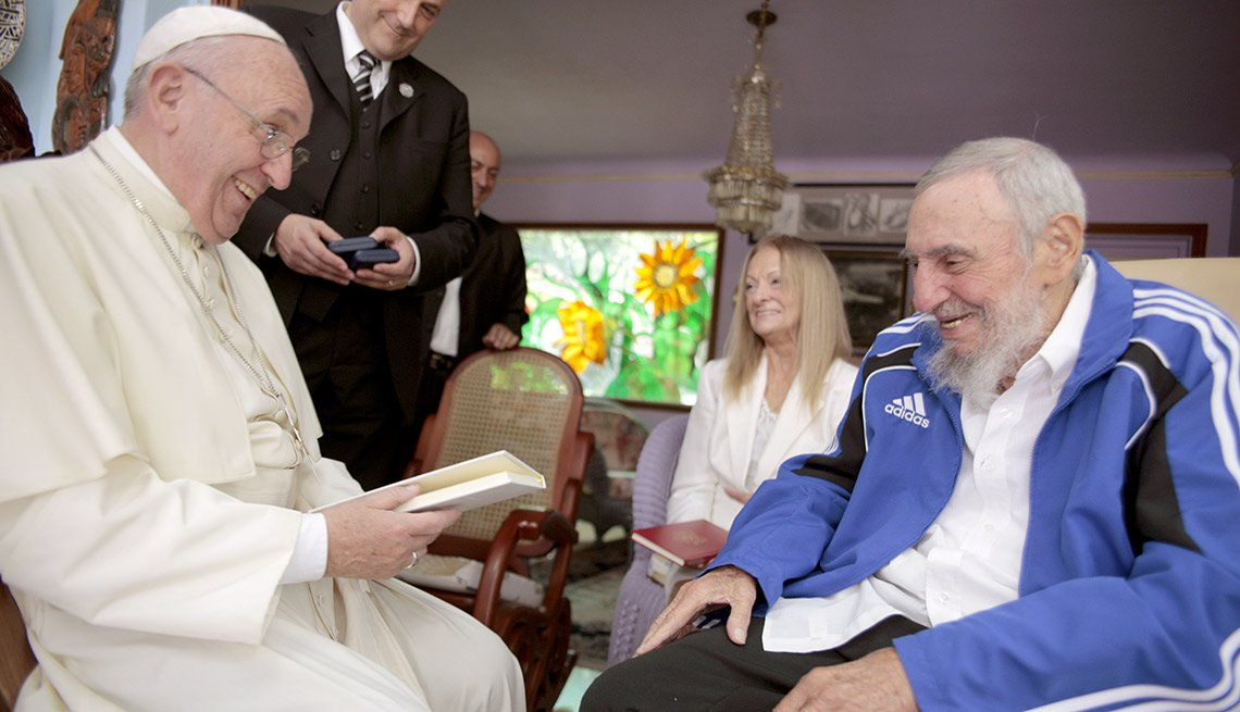 Pope Francis meets Cuba's Fidel Castro, as Castro's wife Dalia Soto del Valle looks on, in Havana, Cuba, Sunday, Sept. 20, 2015. The Vatican described the 40-minute meeting at Castro's residence as informal and familial, with an exchange of books.