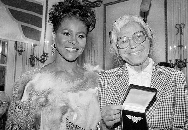 Civil Rights activist Rosa Parks, (R), of Detroit shows off the Wonder Woman Foundation's special 1984 Eleanor Roosevelt Woman of Courage Award presented to her on November 14, 1984. At left is actress Cicely Tyson who presented the award. Parks was honored for her work in the Civil Rights movement.