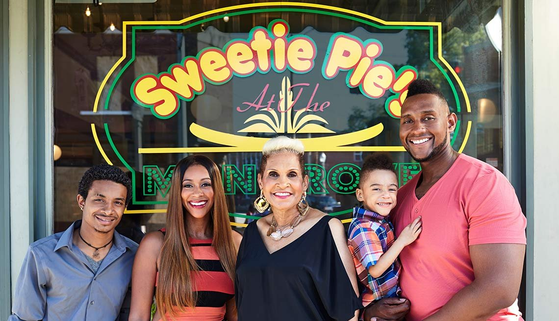 Robbie Montgomery and family in front of one of her restaurants, Sweetie Pie's