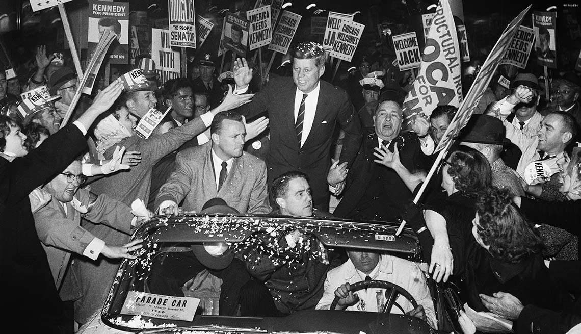Kennedy campaigns with Chicago's mayor, Richard J. Daley, as supporters swarm his motorcade.