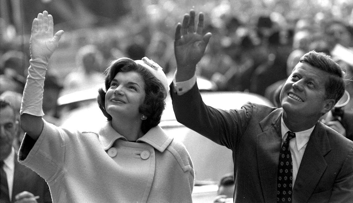 ohn and Jacqueline Kennedy (pregnant with their son, John Jr.) wave to supporters in Manhattan.