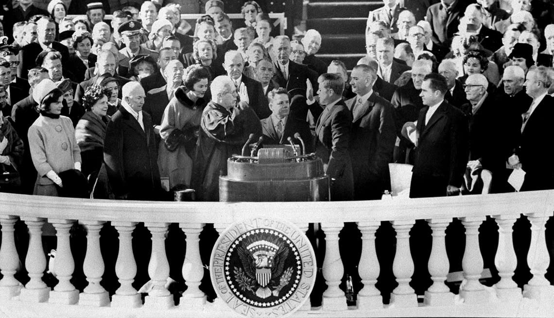 Among those visible nearby on Jan. 21, 1961, as Earl Warren, chief justice of the United States, administers the oath of office to JFK: Jacqueline Kennedy, former President Dwight D. Eisenhower, Vice President Lyndon B. Johnson and former Vice President Richard Nixon.