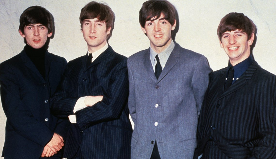 The Beatles From Left To Right: George Harrison, John Lennon, Paul McCartney, Ringo Starr, Musicians, 1963 Was a Year With Lasting Impact, AARP Politics, Events And History
