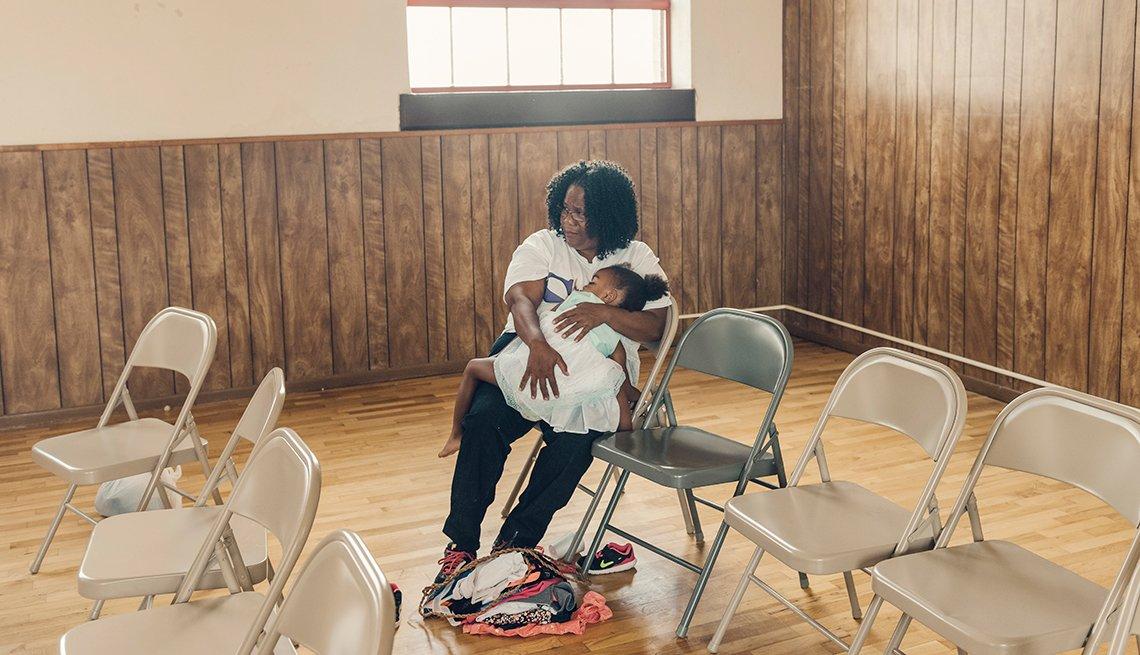 Nicodemus homecoming family reunion - JohnElla Holmes of Nicodemus, Kansas, holds her granddaughter Lauryn Horne