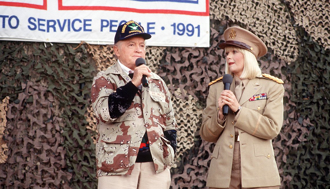 Entertainers Bob Hope and Ann Jillian perform for  military personnel at the USO Christmas Tour during Operation Desert Shield.