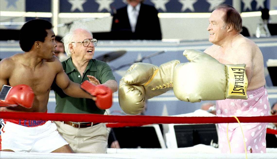 Sugar Ray Leonard, Mickey Rooney, and Bob Hope during Taping of Bob Hope USO 40th Anniversary Show at West Point in West Point, New York, United States.