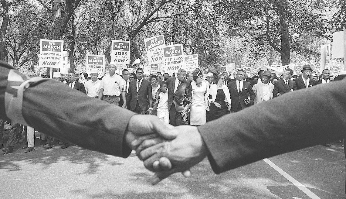 View of the front line of demonstrators during the March on Washington over clasped hands