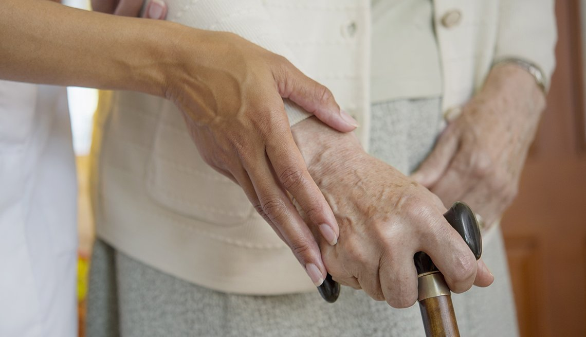 Younger woman, helping older woman, cane, Public Policy Institute, Issues, Long-term care,