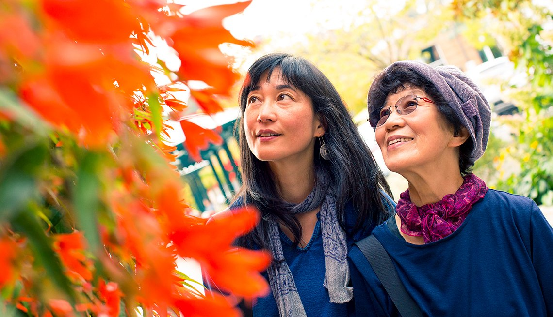 Asian mother and daughter, autumn leaves, Aging, AARP Research, Life, Leisure