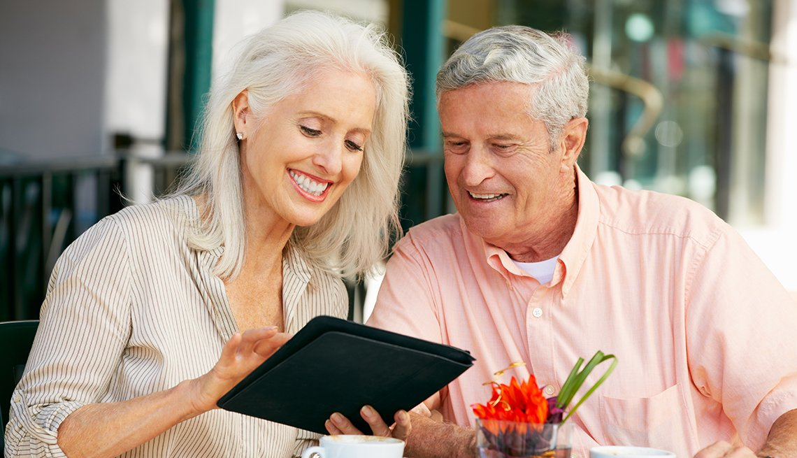 mature couple, tablet computer, outdoor cafe, Mobile technology, AARP Research, Technology