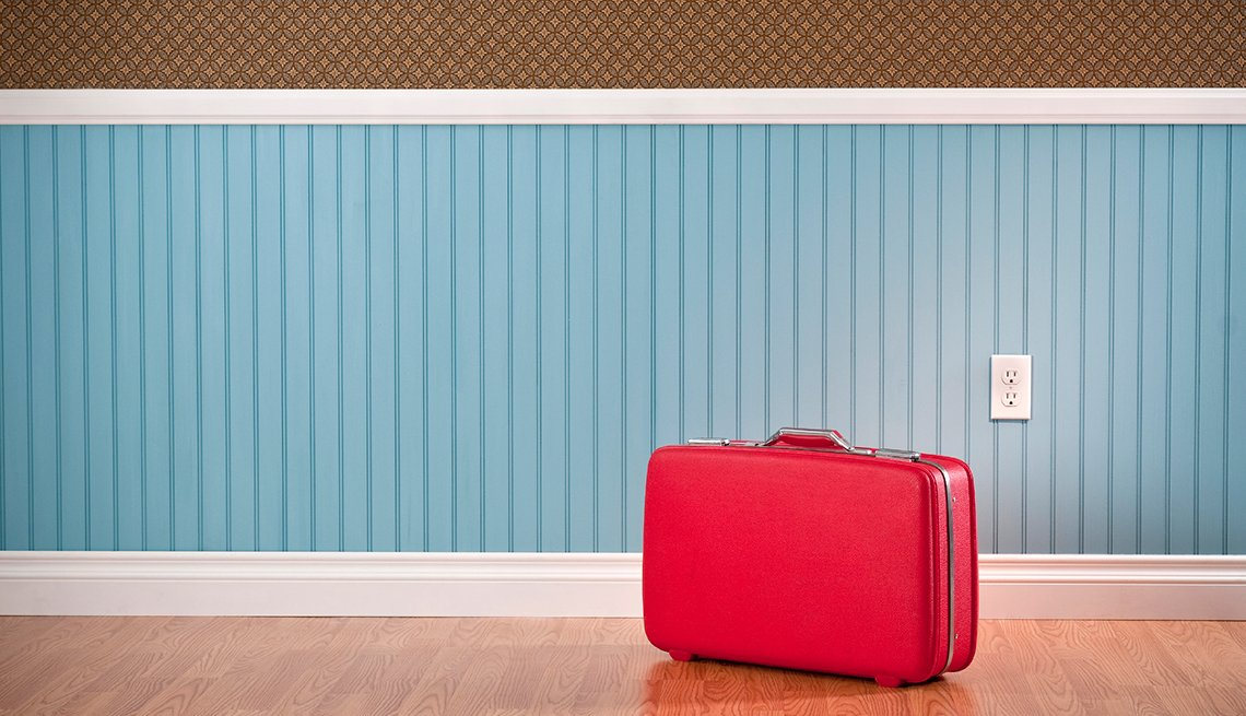 Red suitcase, blue and brown wall, Life and Leisure, AARP Research, Topics and Issues