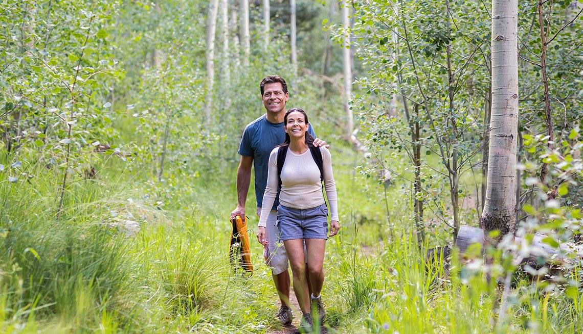 couple walking on a hike in the forest
