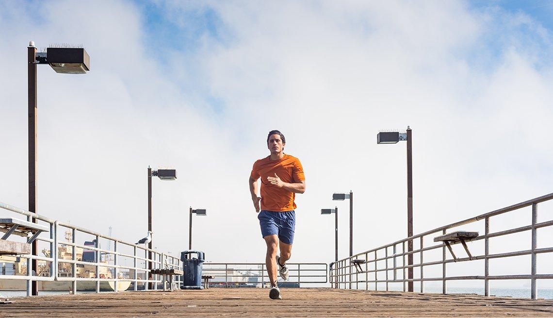 man running on a ocean pier