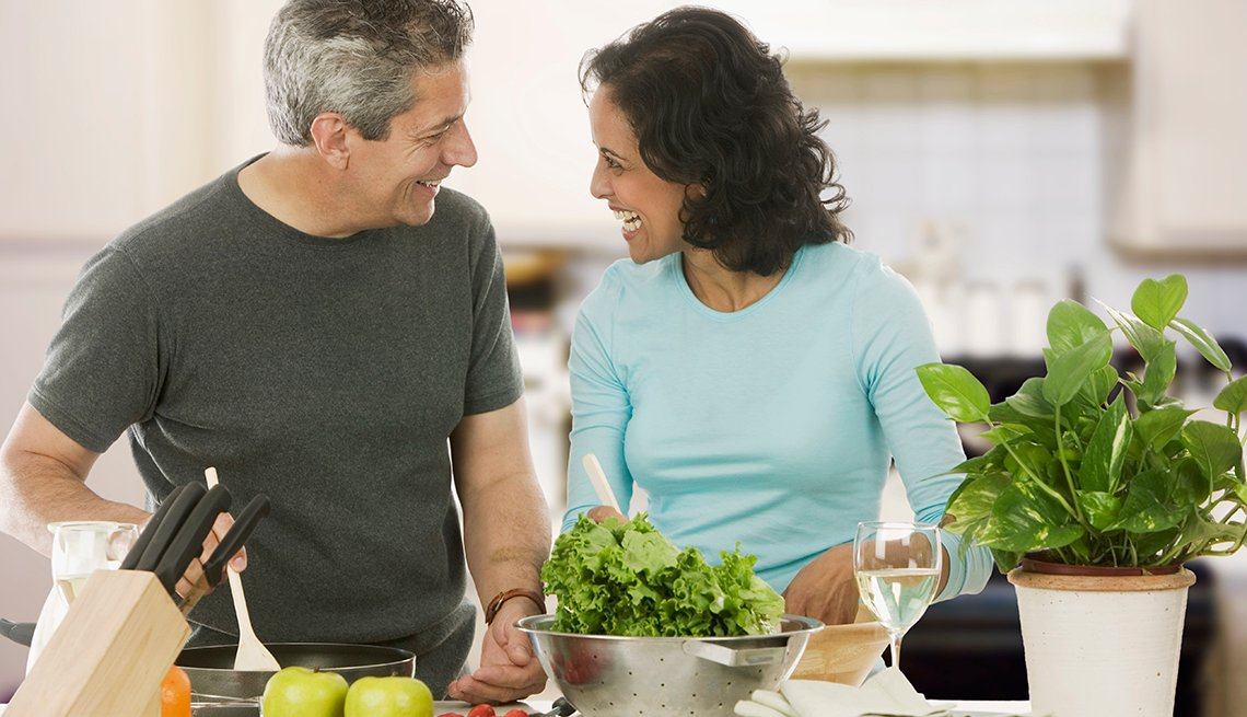 Mature Couple Cooking in Kitchen, Earn Rewards, AARP Rewards for Good