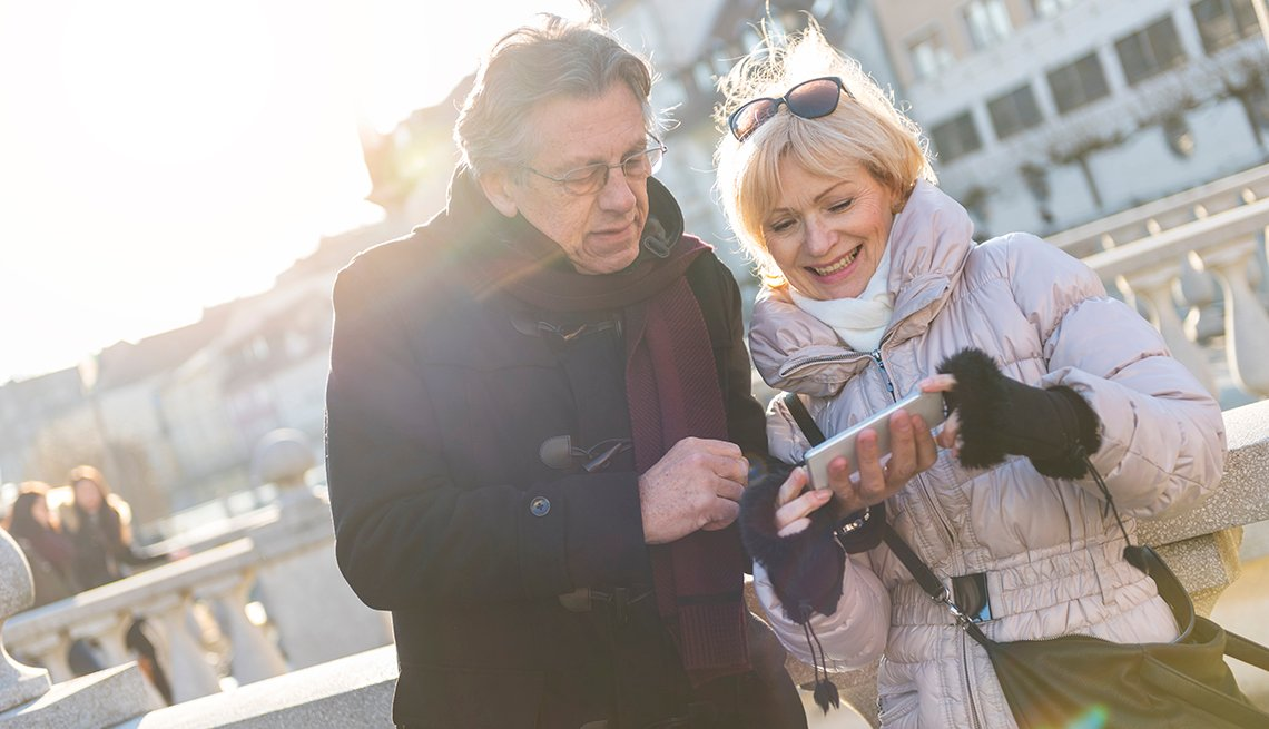 Mature Couple Outside Using Smart Phone, Earn Rewards, AARP Rewards for Good