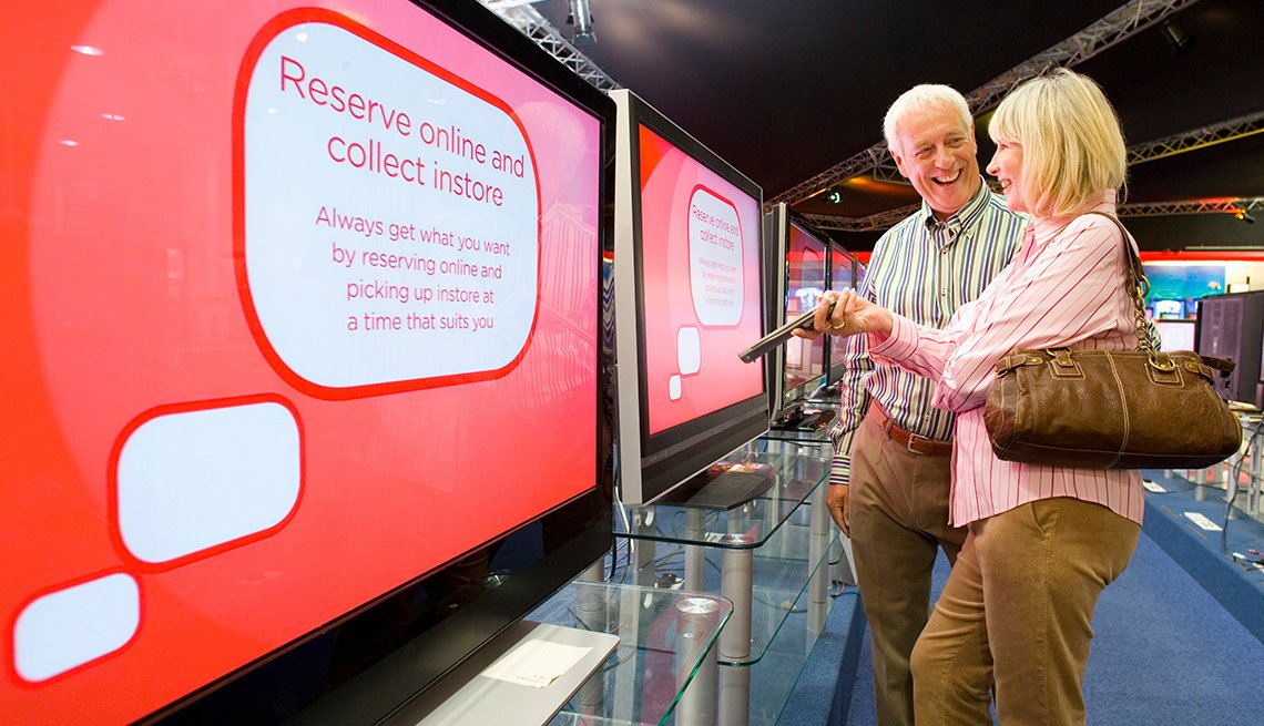 Mature Couple Shopping for Television in Store, Electronic Department, Rewards for Good, December 2017