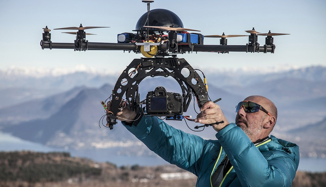 Man Prepares To Release Drone Into Sky, AARP Technology, Innovations, Things You Should Know Before Buying A Drone