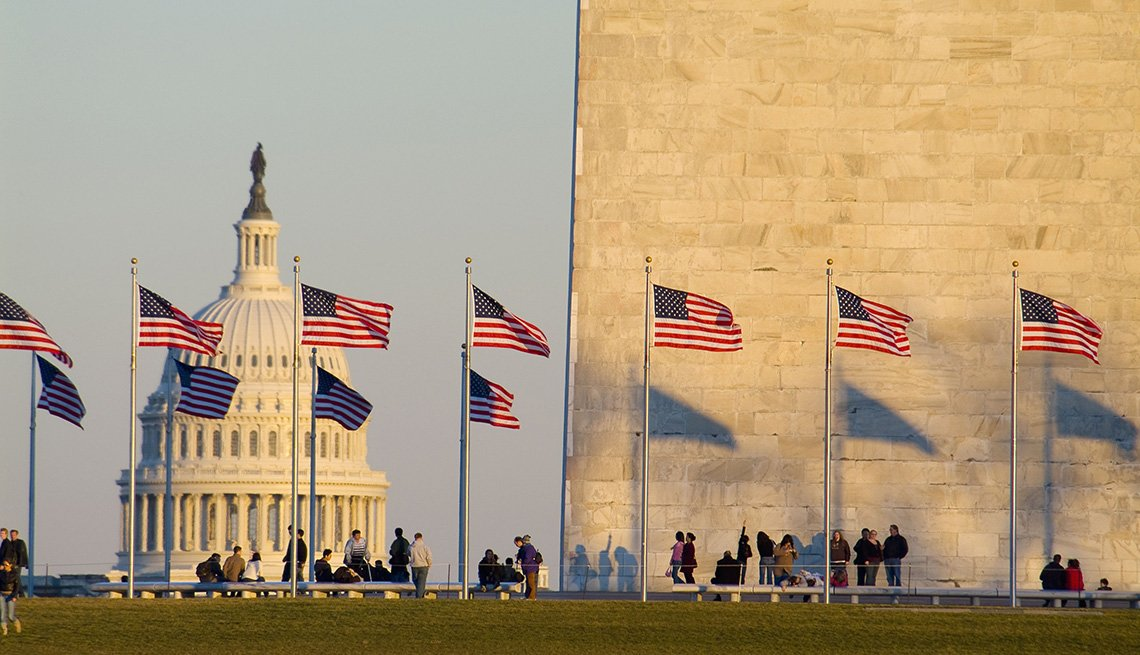 The Washington Monument And Tourists With The Dome Of The Capitol Building In Background In Washington, DC, Free USA Destinations