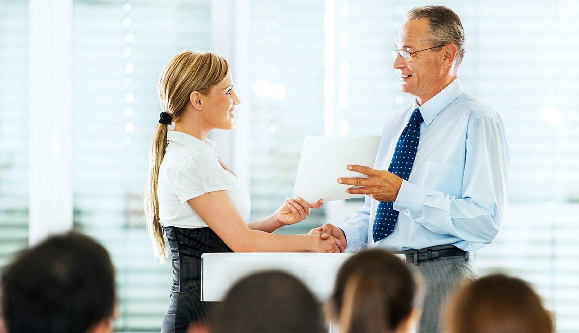 A businesswoman receiving a certificate after a successful training seminar