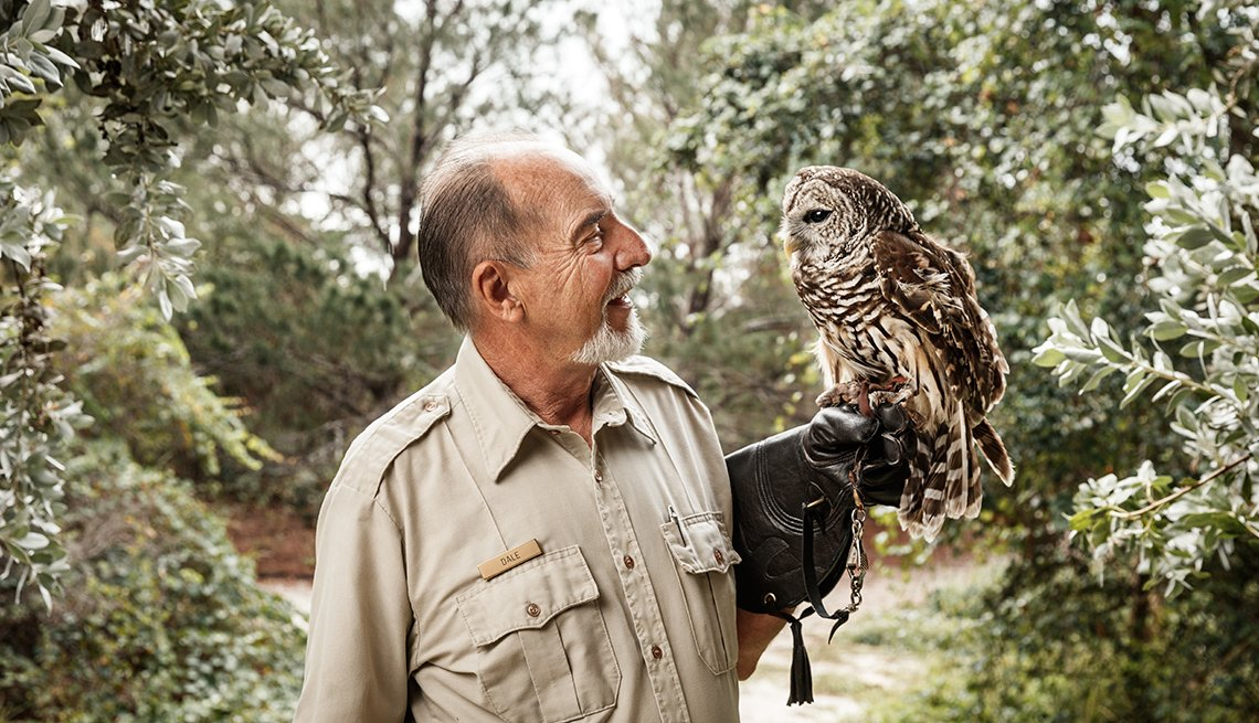 Park Ranger Dale Klco holding an owl at the Hobe Sound National Wildlife Refuge and Nature Center