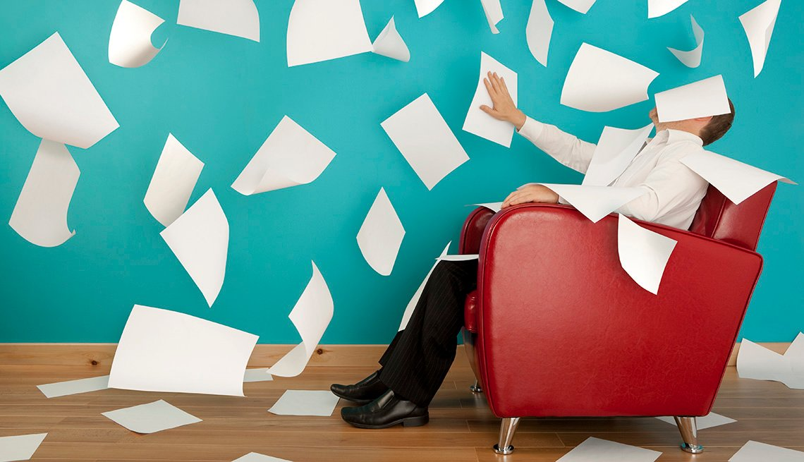 Man In Business Attire Sits In Red Chair With Papers In Air, New Rules For Cover Letters