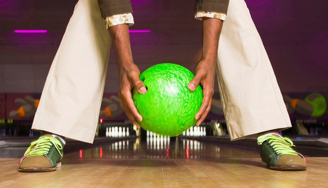 Man Holds Green Bowling Ball, Backwards on Bowling Lane, Lowballed Your Target Salary? Yes, You Can Ask For More